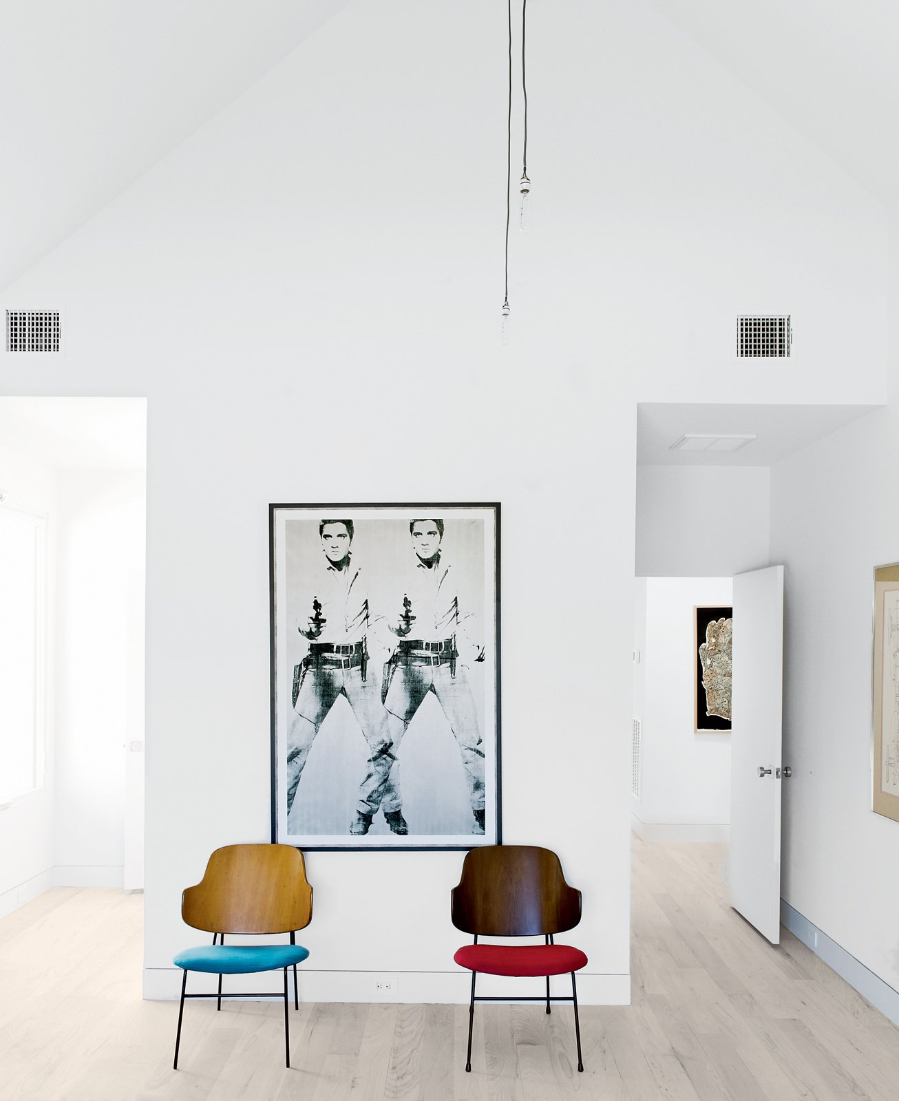 Living Room, Chair, and Light Hardwood Floor A pair of mid-century perches by Kofod-Larsen sit beneath a print by Andy Warhol in an upstairs bedroom.  Photo 4 of 15 in Row on 25th: Affordable Housing Development in Houston