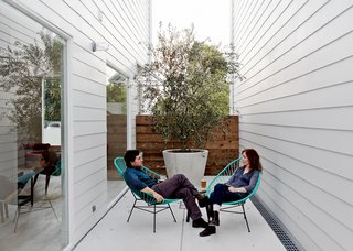 Shannon and his wife, Amy, take the air on a small patio in two Acapulco chairs.