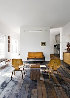 Walsh and Strongin's living room strikes a more rustic note.
