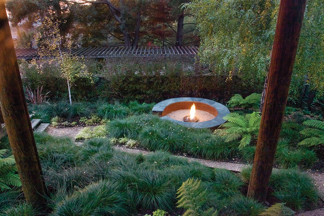 "Made of polished integral concrete with a Cor-Ten steel base, a fire pit ""becomes very much a unique element that sets itself apart in form and color,"" says landscape architect Stefan Thuilot, who designed it.  Photo 1 of 2 in Simple, Concrete-and-Steel Fire Pit in Oakland"
