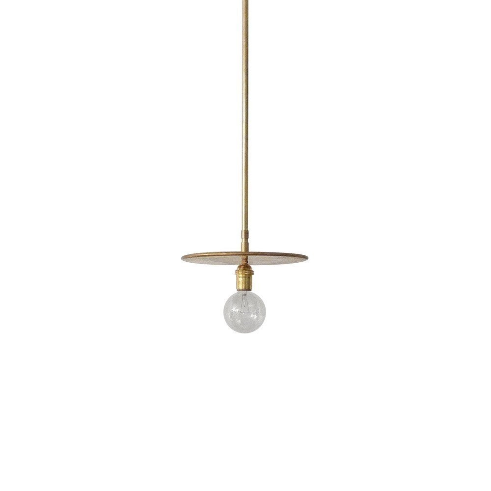 """Paring an overhead light down to a simple, elemental form, the Disc Pendant Light from Workstead is an elegant light with an exposed bulb. Available in brass and blackened brass, the light consists of an arm and adjustable ten-inch disc. The light can be suspended straight from the ceiling, or the disc can be rotated to redirect light as needed.  Search """"aura light"""" from This Just In: Explore New Arrivals at the Dwell Store"""