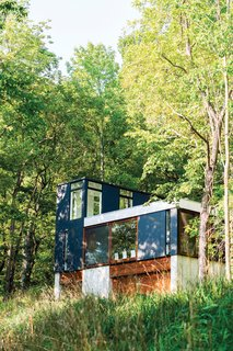 Short StackA tiny cabin in the Wisconsin Woods makes a big impact with Johnsen & Schmaling's innovative stacked design. The resulting cozy abode is stylish and durable, with stunning views of the surrounding landscape.