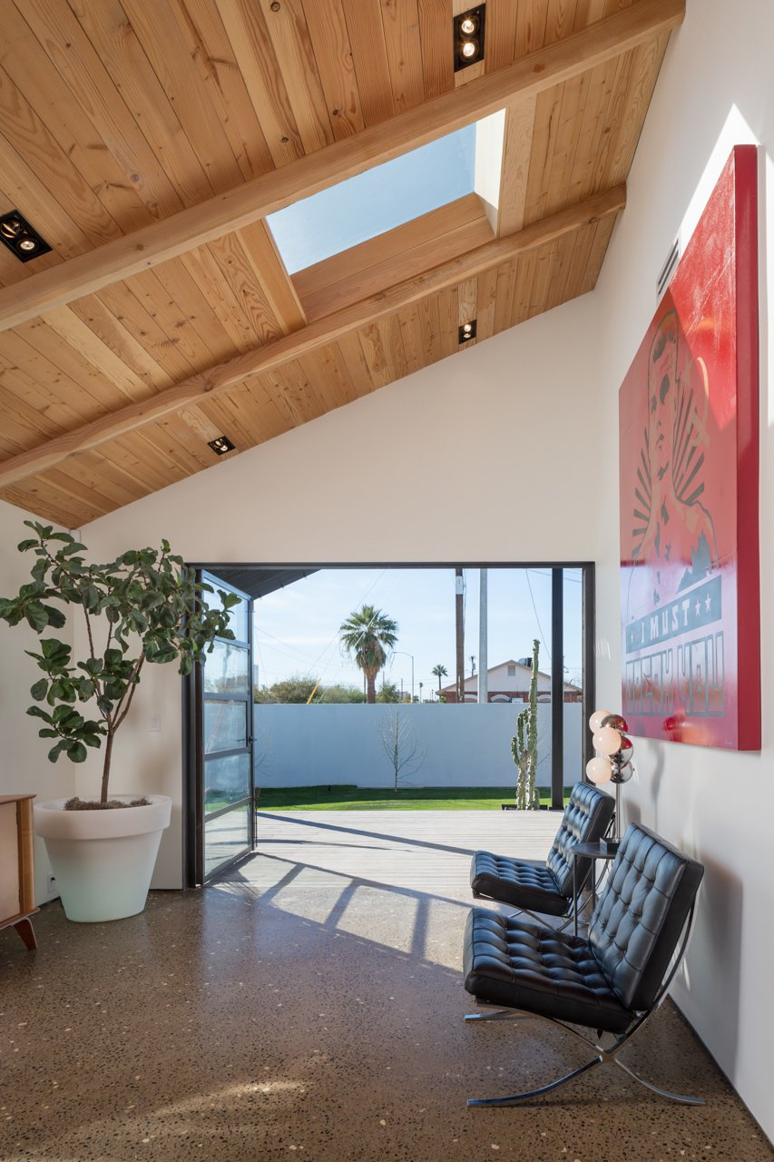 Contreras opted for quality over quantity, sparsely decorating the room leading out to the backyard with a 1950s Thaden Jordan birch credenza and a pair of Barcelona chairs.  100+ Best Modern Seating Designs from Amazing House is Half Historic and Half Modern