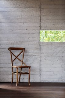 Sawn wood planks add texture to the interior walls.