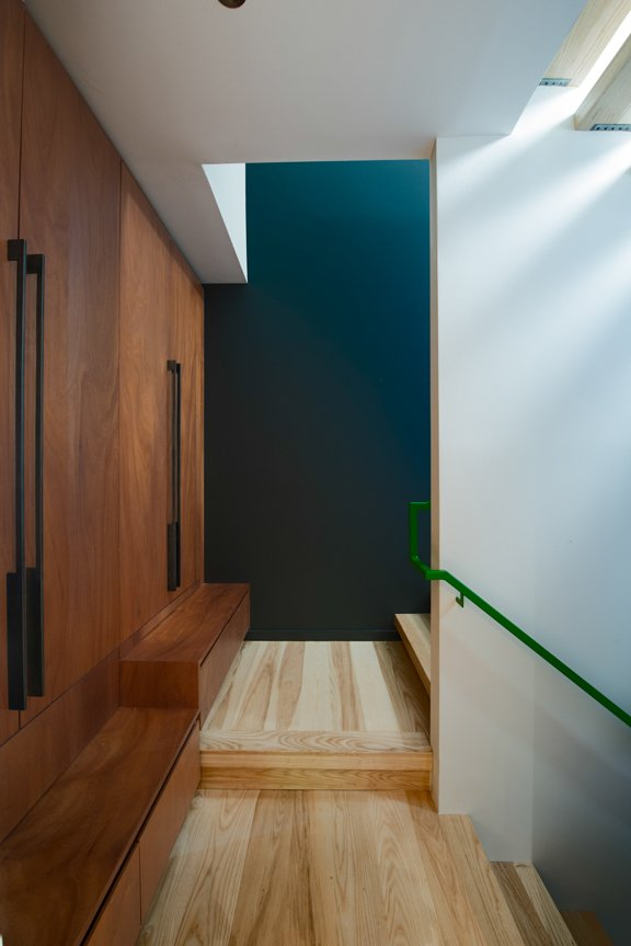 One of the most challenging aspects of the build was incorporating the residents' request for a diverse material palette. The flooring is ash and the cabinetry is Mahogany. Cash Barnes custom fabricated the steel railing as well as the bridge and insect screens.  How to Design with Mahogany by Luke Hopping