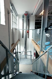 View of the steel pulley system from upstairs. Brod designed the pulley himself, essentially a personal elevator, using nothing but cantilevered body weight to hoist him up and down within seconds.
