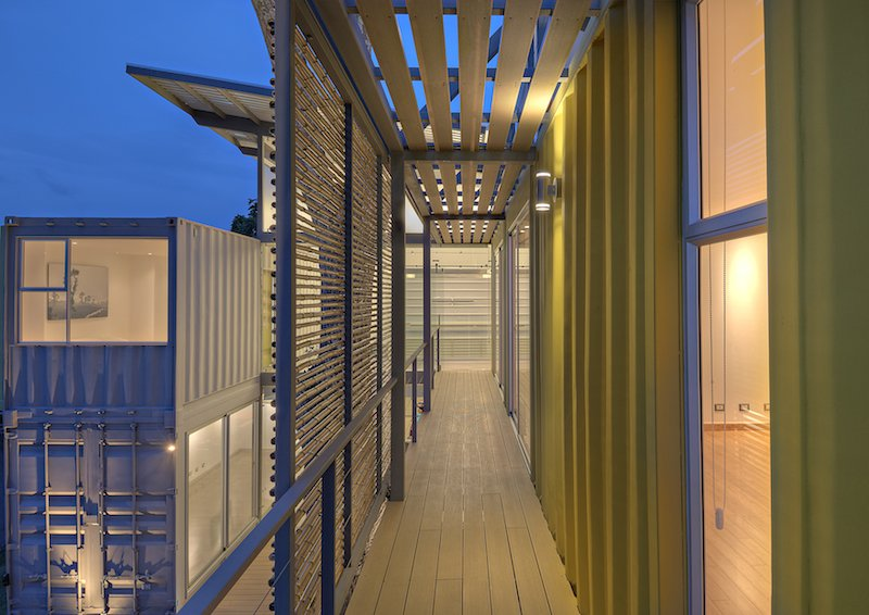 """Outdoor and Decking Patio, Porch, Deck Trejos found that working with the containers was like playing with puzzle pieces. By arranging them in stacks of two and sliding the top containers, she created an interior courtyard and gallery space as well as terraces on the upper level. """"Working with containers for the first time was a big challenge,"""" she says, """"but from the first draft on, it was an awesome experience. They already create space, so you just need to play with the puzzle pieces.""""  Photo 3 of 11 in Who Knew a Relaxing Tropical Retreat Could Be Made of Shipping Containers? from Who Knew a Relaxing Tropical Retreat Could Be Made of Shipping Containers"""