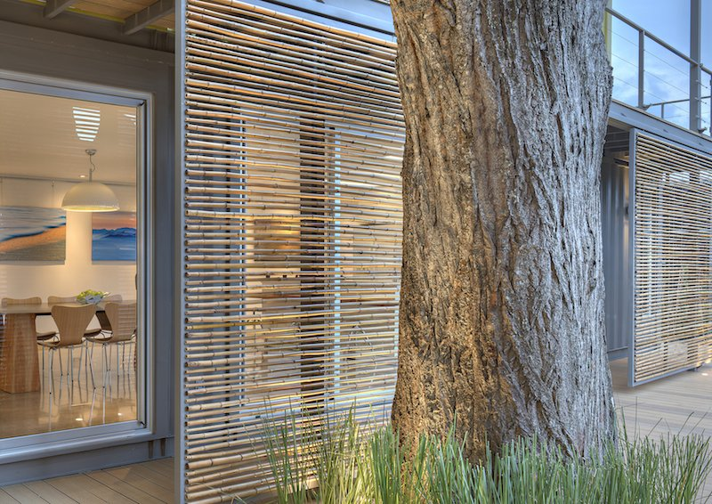 Windows, Sliding Window Type, Wood, and Metal Sliding bamboo panels on the west side of the house can be adjusted to provide shade during the later part of the day.  Shipping Containers by Dwell