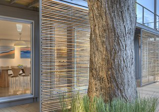 Sliding bamboo panels on the west side of the house can be adjusted to provide shade during the later part of the day.