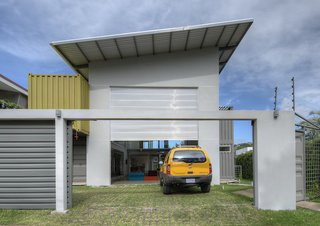 The slanted roof above the garage, painted white to reflect the heat in the tropical environment, also contains a solar heating system for water. The home also features a rainwater collection system, particularly useful during the long rainy season.
