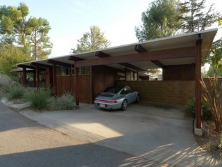 Carport of Arens House (MHA 104).  Los Angeles architect Cory Buckner found great interest in the Crestwood Hills project when she and her late husband, architect Nick Roberts, purchased and restored one of the houses, which was built in 1949. She has since spearheaded a preservation movement of the community tract, prompting the City of Los Angeles to designate 19 of the homes as historic cultural monuments.