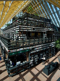 Architecture: Book Mountain, Spijkenisse, the NetherlandsFor optimum browsing, a veritable mountain of bookshelves created by MVRDV houses over a quarter mile of passages through the structure. Perched at the top is a reading room and cafe area with panoramic views through the transparent roof. Photo by Jeroen Musch.