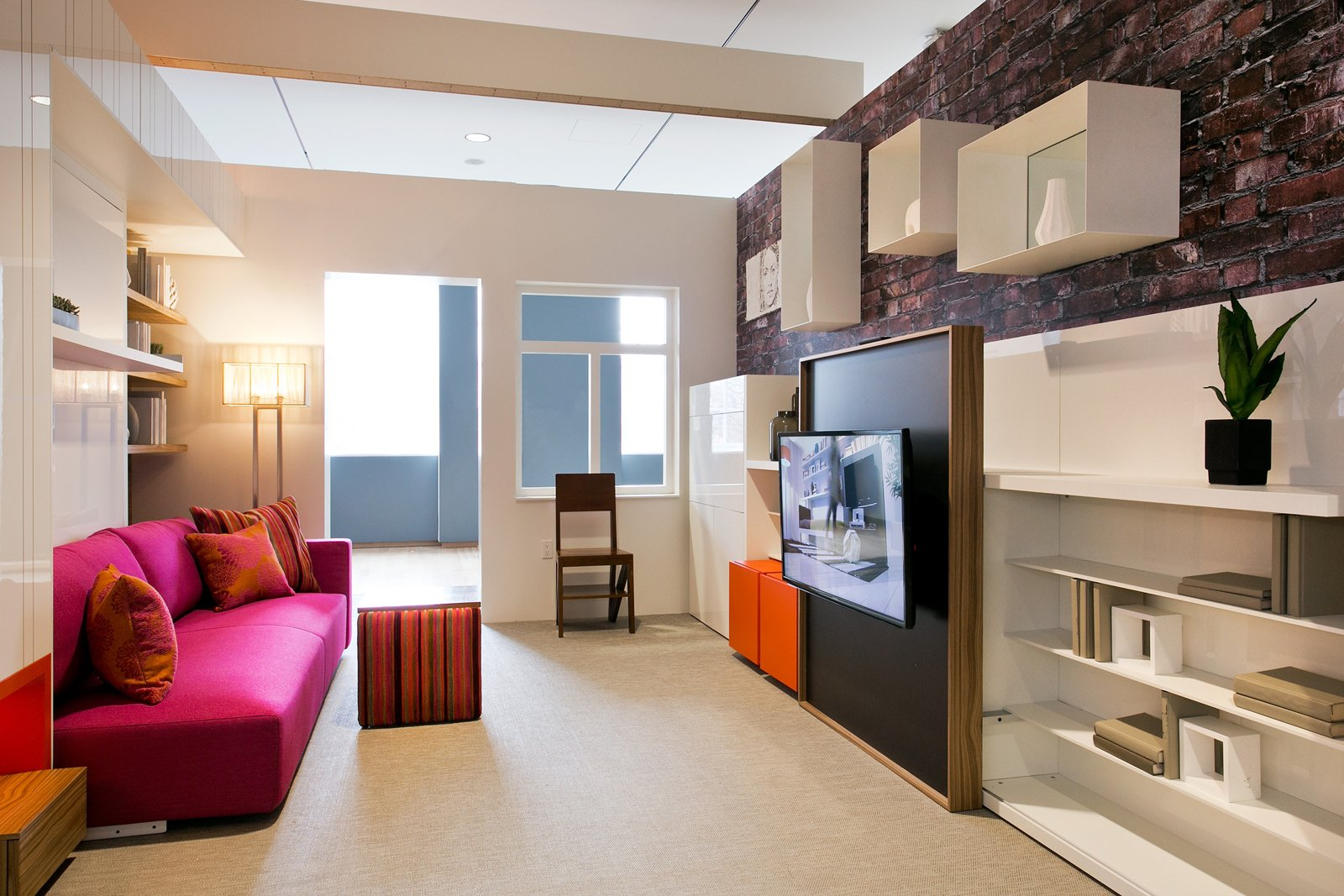 The use of wall space is maximized to keep clutter from the floor and allow for an open feeling. Micro-unit LaunchPad. Clei s.r.l/Resource Furniture; Designed by Pierluigi Colombo and architecture by Amie Gross Architects. Photography by John Halpern. Courtesy of the Museum of the City of New York  Small Spaces from Making Room