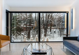 The architecture firm Open Form and the interior design firm Clairoux collaborated on this modern update of a 1950s-era house in Laval, Quebec, north of Montreal.