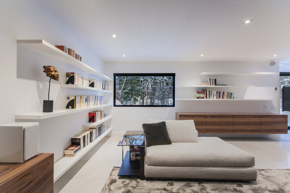 Living Room and Sofa The architects and interior designers did away with the home's cramped, darkened layout and recast the interior as an open space defined by clean lines.  Modern Living Rooms by Luke Hopping from Near Montreal, a 1950s House Gets a Modern Makeover