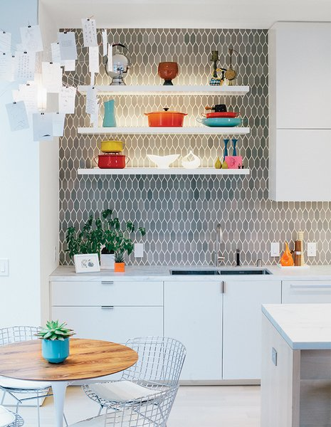 The space is just off the kitchen, which was moved and updated. Bradley paired cabinetry of his own design with tiles from Heath Ceramics.