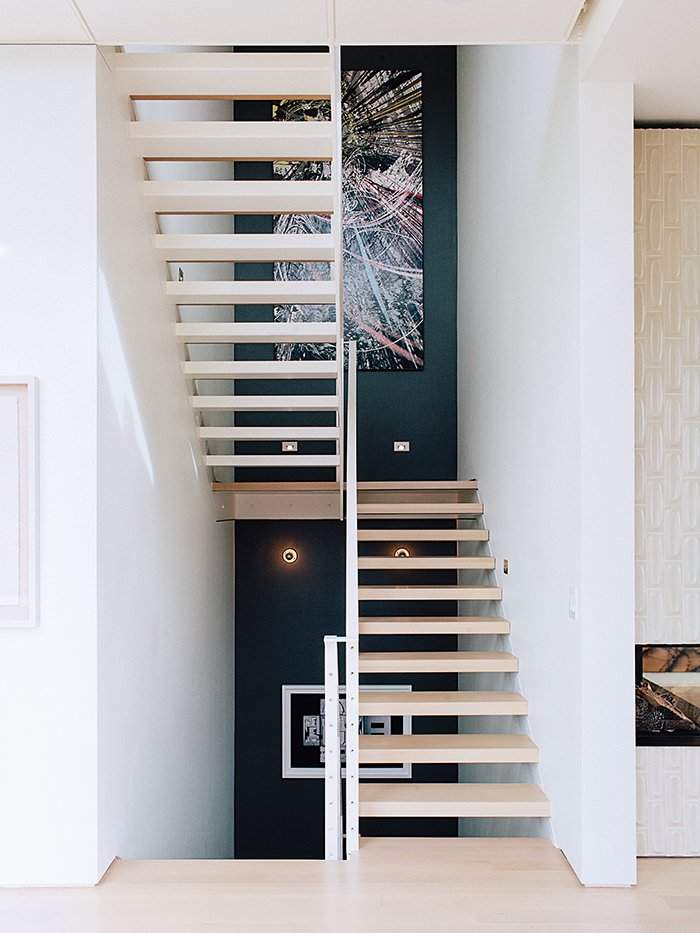 Staircase and Wood Tread Across from the entrance is the main staircase, which leads to the bedrooms.  Photos from A Home with Eclectic Style Looks Just Right