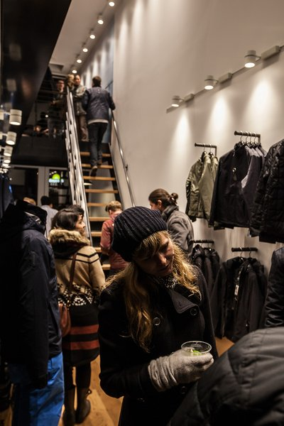 At just nine feet wide, AetherSF succeeds by being a vertical store. A customized dry-cleaner's conveyor belt hoists tons of jackets tens of feet into the sky, essentially suspending the shop's inventory.
