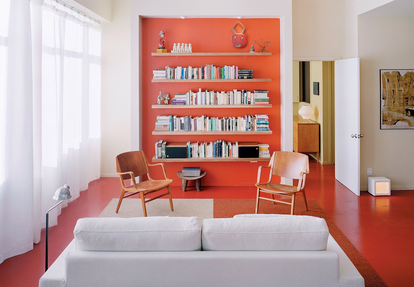 Clean white is supercharged with a background-to-floor-to-fore dose of coral. The adventurous decision to paint the floors makes the room. The background to the home's story is even more beguiling, as one urban resident brings Usonian design to a small city space. It works. Read more.  Photo 15 of 20 in 20 Modern Living Rooms