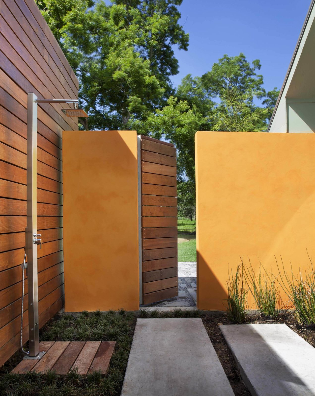 Outdoor The shower offers a multisensory experience: the architect described how clients can take hot showers in the rain or simply lounge in the capacious garden area. Mint plants growing between the pavers release a pleasant smell when stepped upon.  A Renovation Reconnects a House to its Louisiana Landscape by Zachary Edelson
