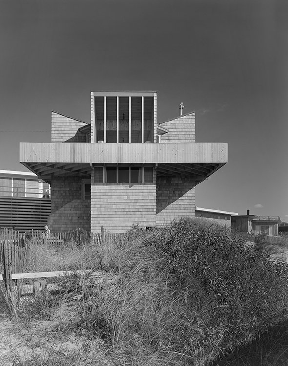 """This 1965 home on Tarpon Walk updates the the shingle-style beach house so common in Long Island vernacular architecture. Delicately balanced on slender tower bases—a """"spaceship"""" as Gifford called it—it hovers over its earthbound neighbors.  Photo 5 of 6 in Take a Peek Inside a Beachside Enclave of Modernist Masterpieces"""