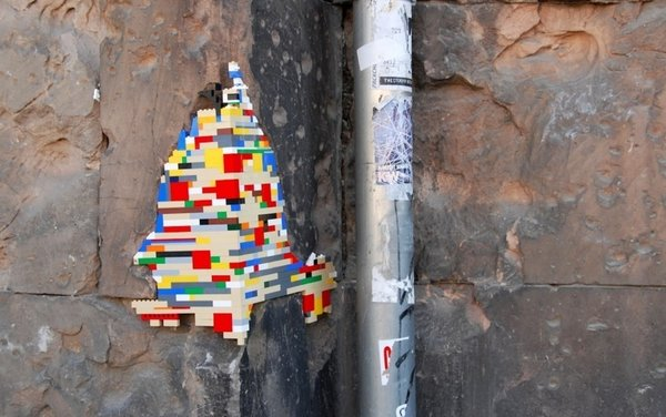 An uneven stone wall is a fitting spot for Lego bombing.