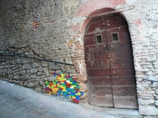 Spied on the Archiculture blog: a centuries-old cobbled wall appears to enjoy a little extra support by way of Lego. (Notice the toys filling various nooks and crannies, too.)