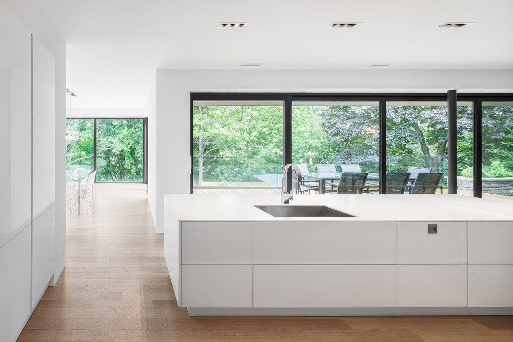A view of the backyard through the kitchen.  Prince-Philip Residence by William Lamb
