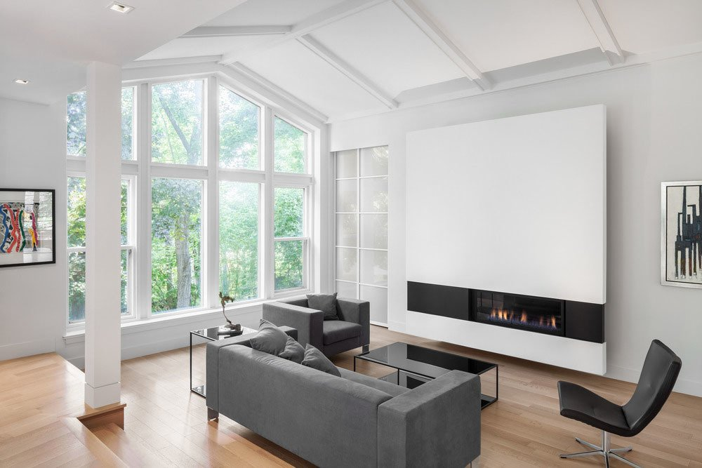 A wall-mounted fireplace is a dominant feature in the living room.  97+ Modern Fireplace Ideas from Prince-Philip Residence