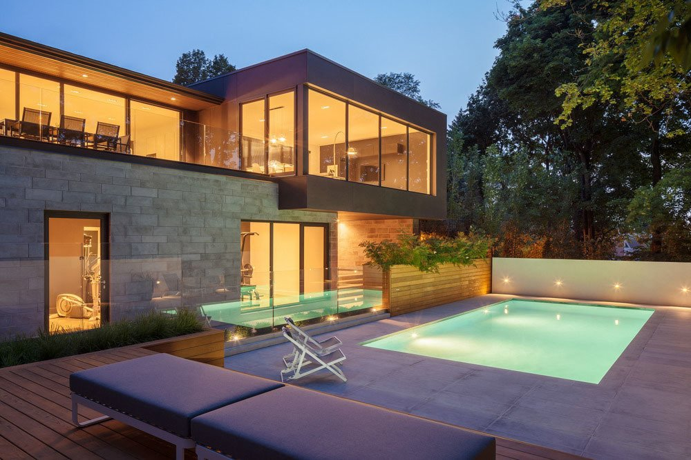 The cantilevered extension is clad in anthracide-colored concrete panels that reflect the limesone that was used to line the swimming pool.  Prince-Philip Residence by William Lamb