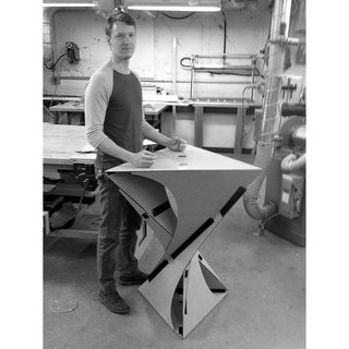 Tom MacDonald poses with the full-scale prototype of the Kabu, which he designed with his fellow students Alex Chin and Shai Gerner.