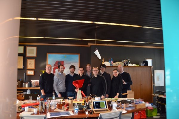 Alberto Alessi of Alessi, far left, and Jordan Goldstein of Gensler, fourth from right, with students and Alessi employees at the company's factory in Italy last month.