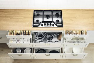 This kitchen system keeps everything organized with drawers for pots, knives, table linens, and dinnerware.