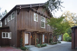 This former horse stable in Marin County, which was built beside the old Northwest Pacific Railroad in the early 1900s, was used as a guesthouse and garage until recently, when its water pipes burst, resulting in significant damage. Architect Heidi Richardson then stepped in to repair and elevate the historic barn. Today, it is wrapped in recycled redwood, some of which was reclaimed from the original structure.