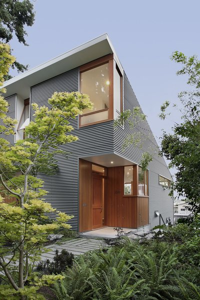 The house has a small environmental footprint. SHED built it using advanced framing, a technique that cuts down on the use of lumber by 30 percent. Another benefit of the method is that it prevents heat from escaping the home, making it more energy-efficient. Additionally, the architects installed a high-efficiency boiler that preheats water with rooftop solar panels; a heat recovery ventilation system that efficiently controls the climate; and a rainwater retention tank that conserves water.