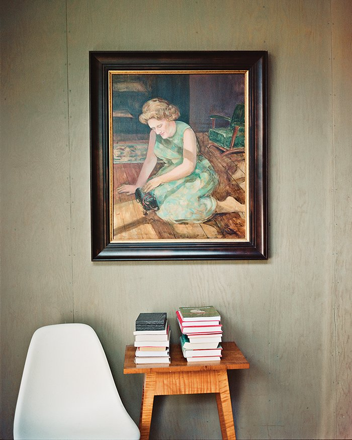 Living Room and Chair One of the bedrooms became a guest room and study, where a portrait of Green's mother by Evelyn Spence-Reeve hangs above a vintage table.  Photo 10 of 15 in L.A. Renovation Respects Midcentury Bones (While Adding Some Flair)