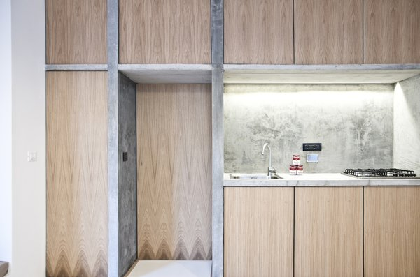 Despite the cast-on-site concrete dividers, there's still an airy sense of space; the dividers support, instead of overwhelm. This approach came from the architects' constant sense of experimentation and playfulness, a deliberate approach that helped them find new ways to use recycled and salvaged materials.