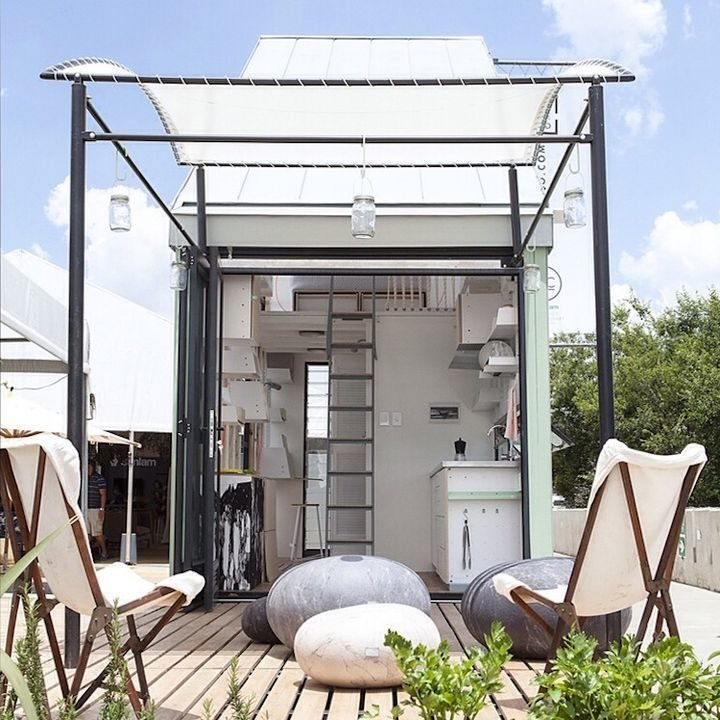 A wavy retractable awning structurally defines the outdoor space of this prefab pod concept in South Africa.  Photo 9 of 10 in 10 Tiny Homes You Can Build from Instantly Appealing Awnings