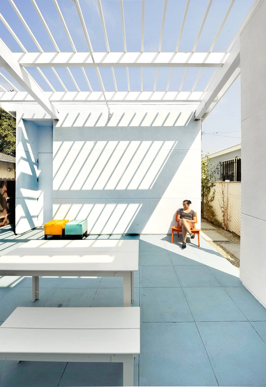"""""""Color simply and cost-effectively enriched and made the architectural idea palpable and pleasurable,"""" Lehrer says about the prismatic theme. """"It was used to explicitly articulate and dramatically enhance the circulation and spatial concepts. It helps make modest, but wonderful, spaces a little magical.""""  Photo 8 of 11 in Vibrant Affordable Housing Prototypes in Los Angeles"""