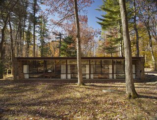 Eliot Noyes's 1954 home is a simple, one-story building clad in fieldstone and wood, which blends easily into the landscape.