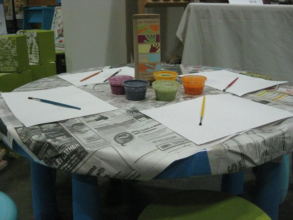 A painting table was one of the several interactive exhibits at Modern Family.