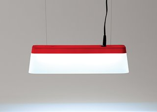 A 3-D printed accessory by Takt Project transforms a Muji frosted pencil holder into a pendant lamp.