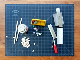 """""""99 percent of the miniatures featured in the book were made painstakingly with hand tools: Xacto knives, sandpaper, felt, a needle and thread, strips of basswood, and mahogany—things you can find at a great art supply store,"""" Chun says. """"I only recently got a Dremel rotary tool to help with sanding the curves of a Saarinen dining table. But overall, the simple, clean lines—often pure geometry—found in mid-century and Danish modern sensibilities helps with creating pieces at this scale."""""""