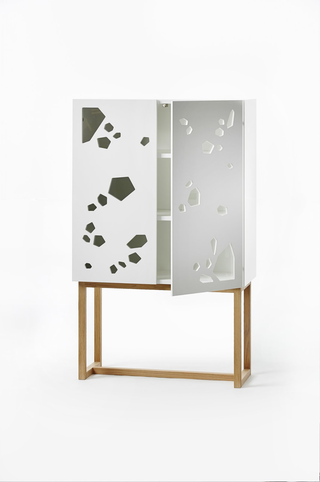 Using geometric shapes, designers Sara and Anna Larsson at young furniture brand A2 (established 2008) gives the Sneak Peek cabinet a playful twist. The pattern of irregular holes makes it possible to display favorite items and hide the rest. The cabinet is handcrafted in Sweden, and is available with base or frame.  On the Scene at Stockholm Design Week 2013 by Marianne Johnsgård