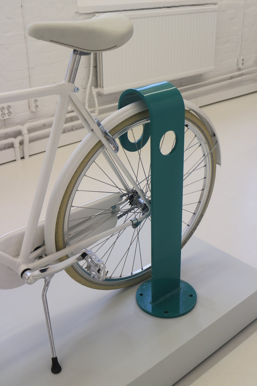 Stockholm-based Note Design Studio works within interior design, architecture, and graphic design as well as product design. For producer Nola, the studio has made the Hook cycle stand. A broad metal band forms the structure and makes it stand out, while the narrow width makes it seem smaller at a closer distance. The stand is available in pastel blue as well as orange and light grey.  On the Scene at Stockholm Design Week 2013 by Marianne Johnsgård