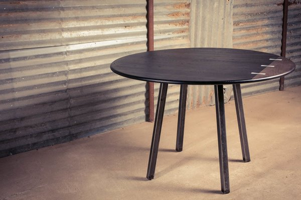 This round table is made from solid white oak and hard maple.