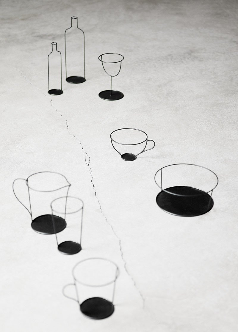 "Nendo's Small Black Vase is a collection of sculptural metal frames with a strong graphic look that combined with a glass turns into a vase. Produced by David Design.  Search ""lyngby vase"" from On the Scene at Stockholm Design Week 2013: Furniture Fair"