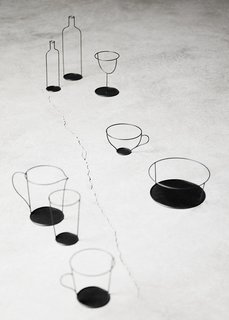 Nendo's Small Black Vase is a collection of sculptural metal frames with a strong graphic look that combined with a glass turns into a vase. Produced by David Design.