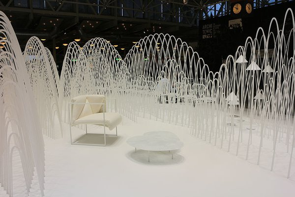 It is about the creation of products rather than the products themselves, says Oki Sato of the Nendo installation in the entrance hall of Stockholm Furniture Fair. 80 lasercut sheets of Forex foam board take on mountain-like shapes when stretched, and create a partly invisible landscape surrounding examples of Nendo's designs up through the last decade.