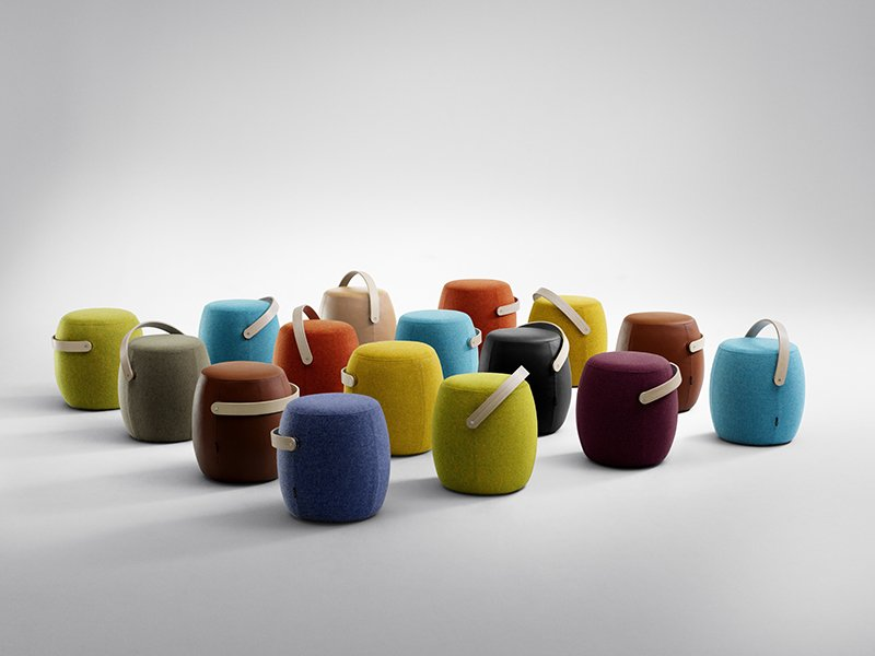 """Offecct offers a playful portable seating solution with its Carry-On by designer Mattias Stenberg. It is a contemporary take on the pouf with a solid wood handle that makes it easy to take with you. The Carry-On is stackable and comes in a wide range of colors.  Search """"promo daily mattia balsamini"""" from On the Scene at Stockholm Design Week 2013: Furniture Fair"""